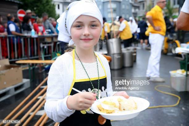 A girl holds a plate with omlette after the Members of the World Brotherhood of the Huge Omelet cooked giant omlette within a 4 metre diameter frying...