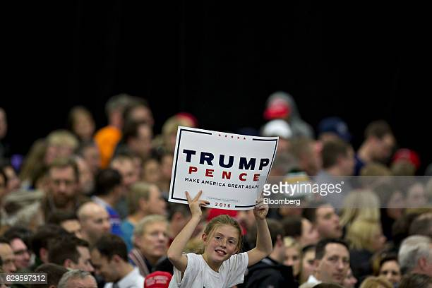 Girl holds a sign as she waits for the arrival of U.S. President-elect Donald Trump, not pictured, during an event in West Allis, Wisconsin, U.S., on...