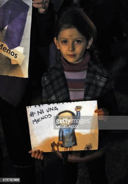 A girl holds a sign during a march under the motto 'Ni una menos' against feminicide in Montevideo on June 3 2015 AFP PHOTO/ Miguel ROJO