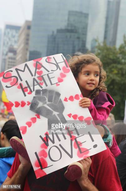 Girl holds a sign saying 'Smash hate with Love' during a rally against White Supremacy and Islamophobia at Queen's Park in Toronto Ontario Canada on...