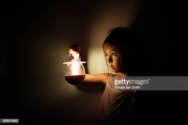 Girl holds electric lantern