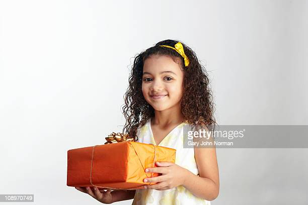 girl holds gift - receiving stock pictures, royalty-free photos & images