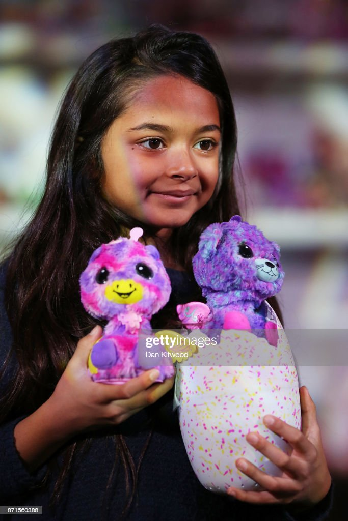 A girl holds some 'Hatchimals' while posing for a photographer during a media event announcing the top 12 toys for christmas at St Mary's Church in Marylebone on November 8, 2017 in London, England. The Toy Retailers Association's Dream Toys chart, is an independent list of the predicted Christmas best-selling gifts for children.
