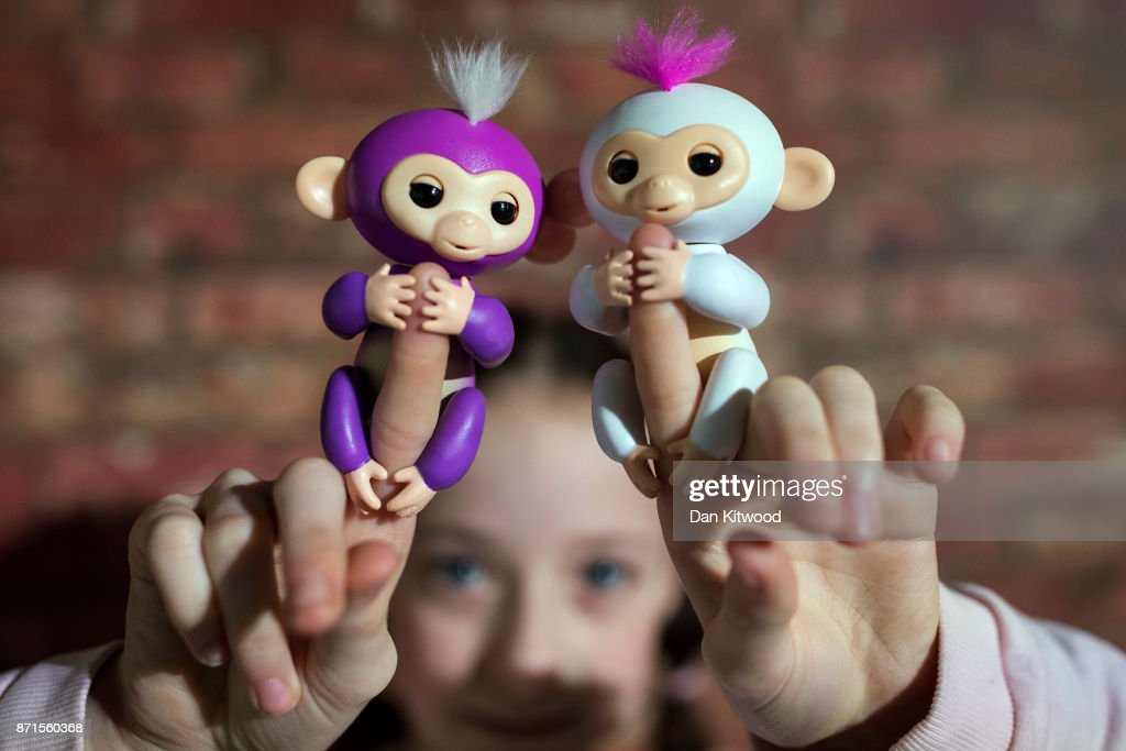 A girl holds two 'Fingerlings', during a media event announcing the top 12 toys for christmas at St Mary's Church in Marylebone on November 8, 2017 in London, England. The Toy Retailers Association's Dream Toys chart, is an independent list of the predicted Christmas best-selling gifts for children.