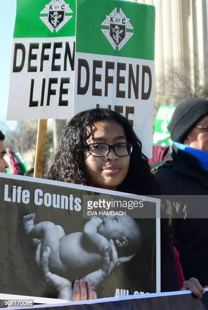A girl holds up a sign as antiabortion activists from around the US gather in Washington DC January 19 2018 for the annual 'March for Life' / AFP...