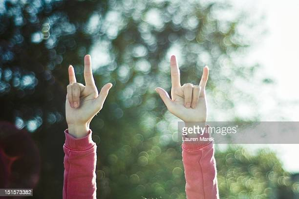 girl holds up - i love you stock pictures, royalty-free photos & images