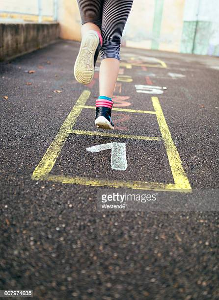 girl hopscotching - hopscotch stock pictures, royalty-free photos & images