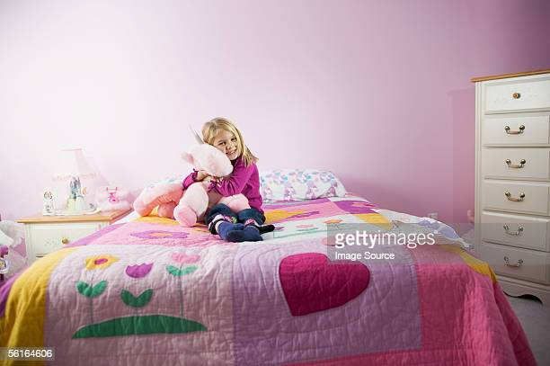 Girl hugging a toy in her room