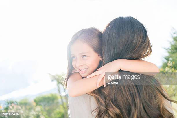 Girl hugging and celebrating mother's day