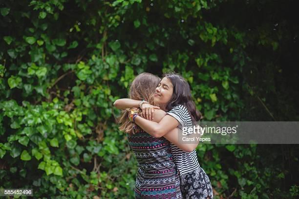 girl hugging best friend