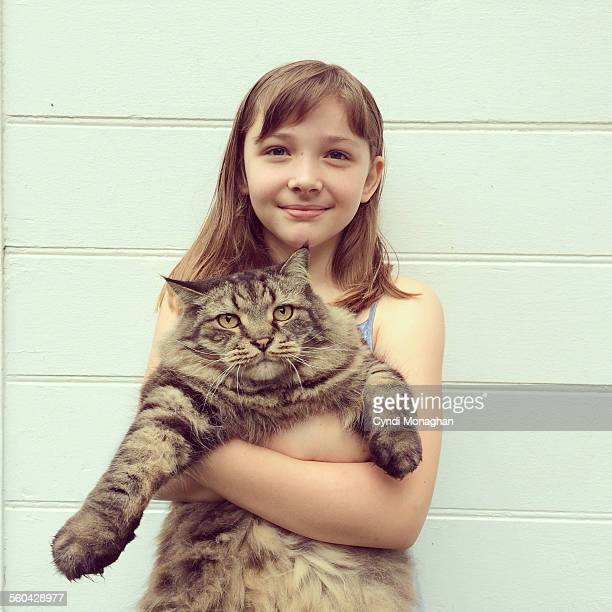 girl hugging cat - hairy little girls stock photos and pictures