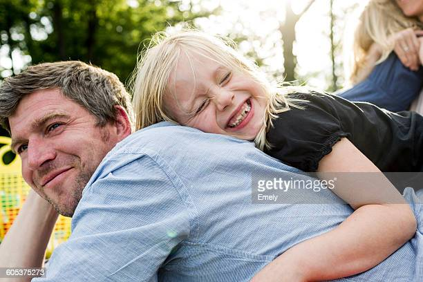 Girl hugging father in park