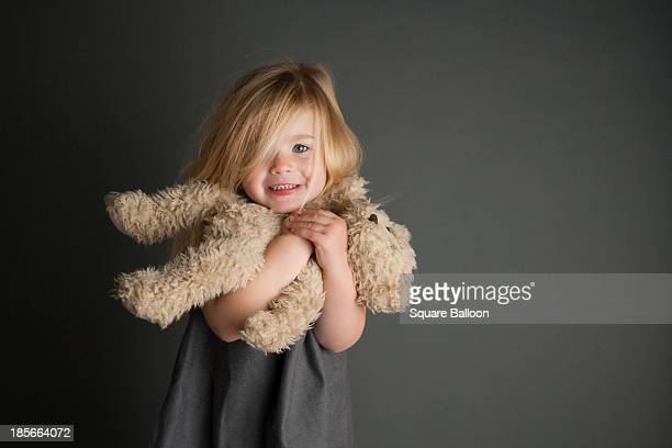 girl hugging her teddy - stuffed toy stock pictures, royalty-free photos & images