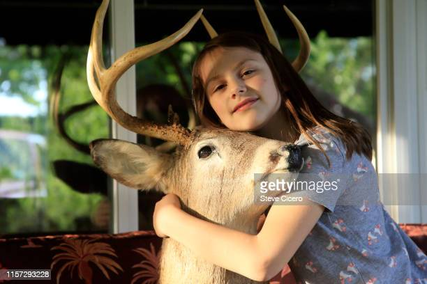 girl hugging taxidermy dear head - dead girl stock pictures, royalty-free photos & images
