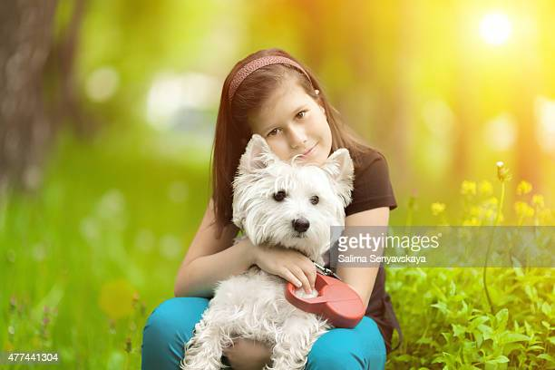 Girl hugging westie