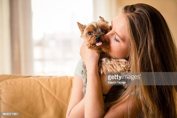 Girl hugging with her dog