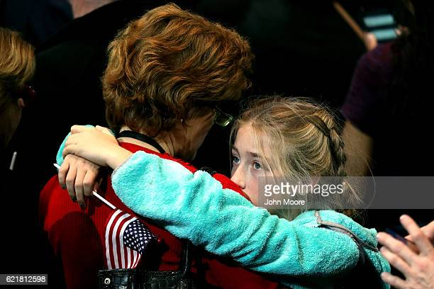 A girl hugs a woman as she watches voting results at Democratic presidential nominee former Secretary of State Hillary Clinton's election night event...