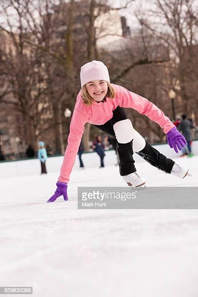 girl ice skating on a rink - スケート靴 ストックフォトと画像