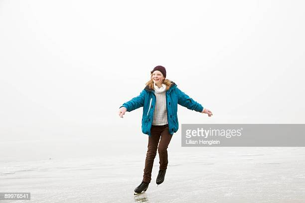 Girl iceskating on frozen lake