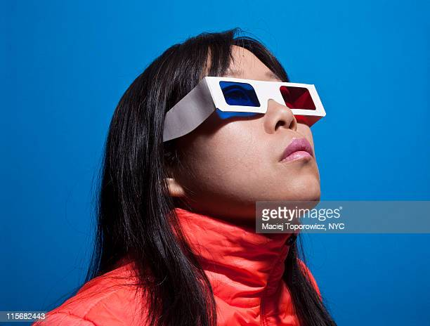 Girl in 3-D glasses on  blue background