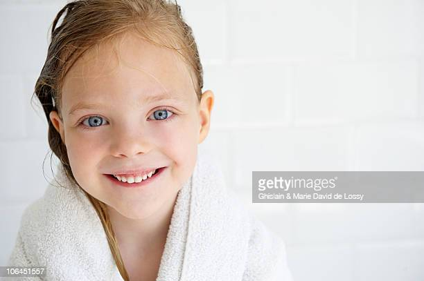 Girl in a bath towel, looking at camera