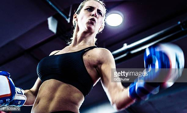 girl in a boxing ring - girl fight stock photos and pictures