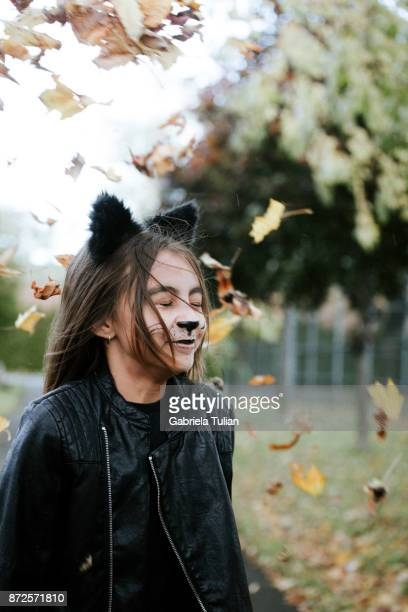 girl in a cat's costume at halloween - cat costume stock photos and pictures