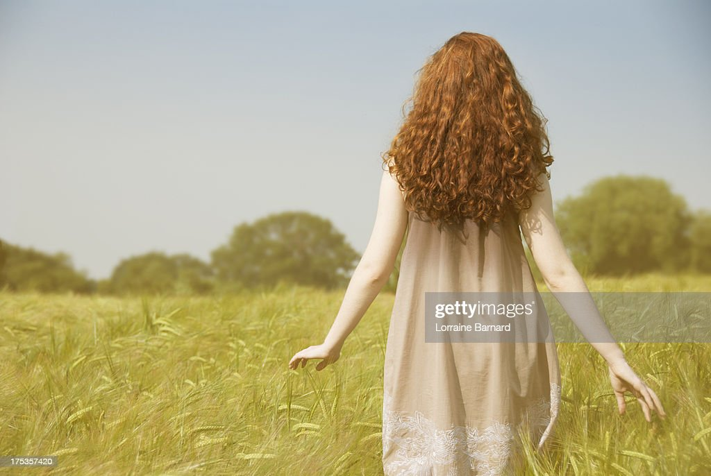 Girl in a cornfield with long hair : Stock Photo