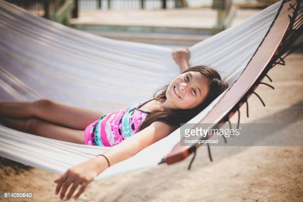 girl in a hammock - kids swimsuit models stock pictures, royalty-free photos & images
