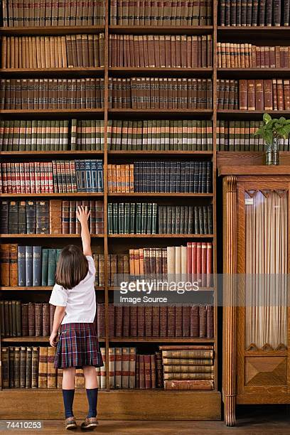 girl in a library - library stock photos and pictures