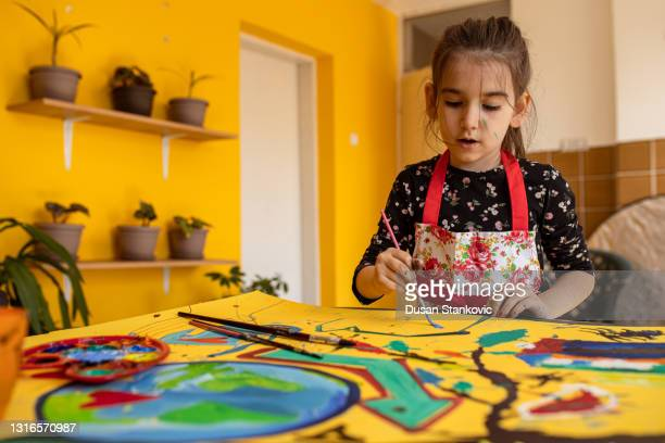 girl in a painting action - tempera painting stock pictures, royalty-free photos & images