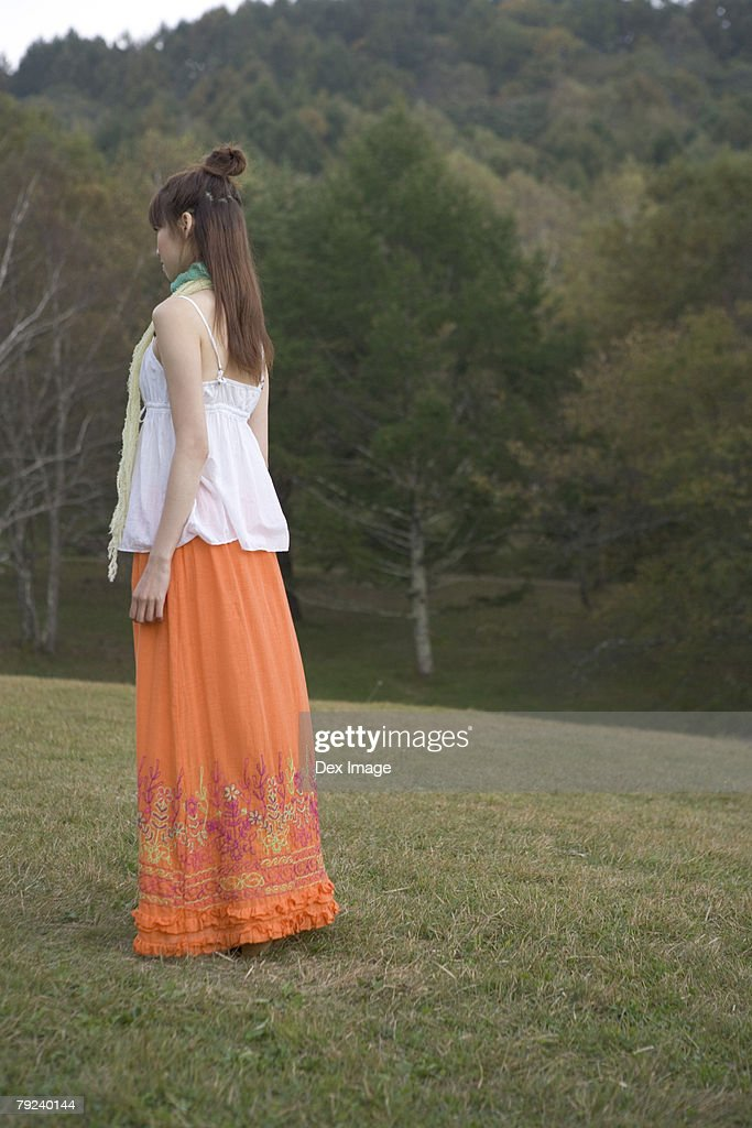 Girl in a park, alone : Stock Photo