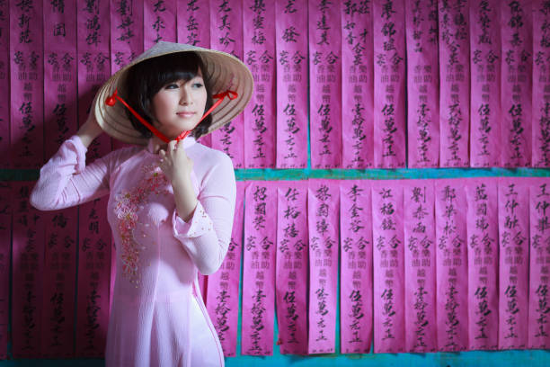 A Girl In A Pink Ao Dai And A Non La Wall Art