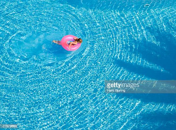 A girl in a pool.