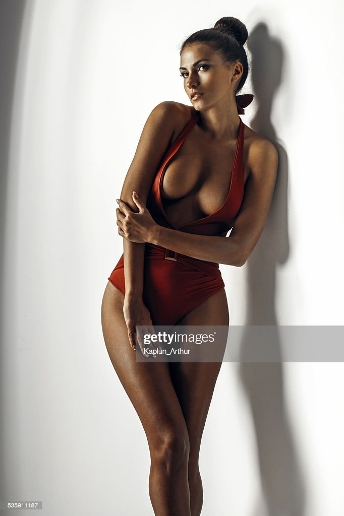 Girl in a red bathing suit : Stock Photo