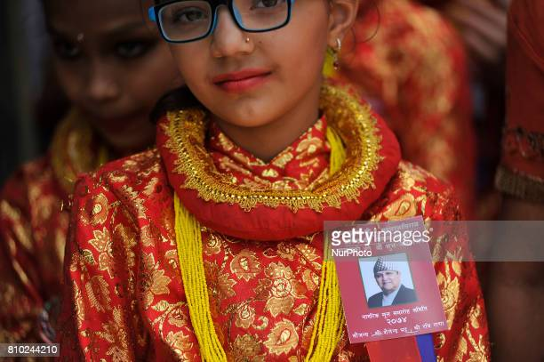 Girl in a traditional attire arrives to offer greeting towards Former King Gyanendra Shah during on his 71th birthday at his residence Nirmal Niwas,...