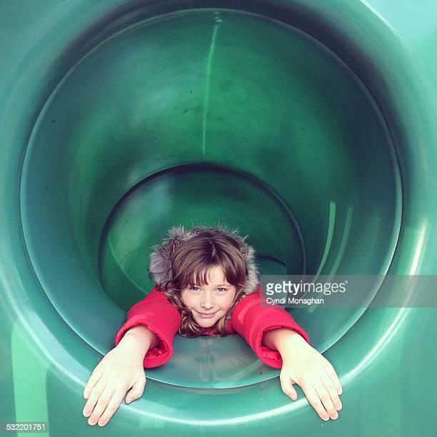 Girl in a tunnel slide