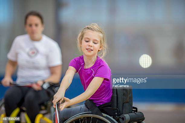 Girl in a Wheelchair Playing Sports