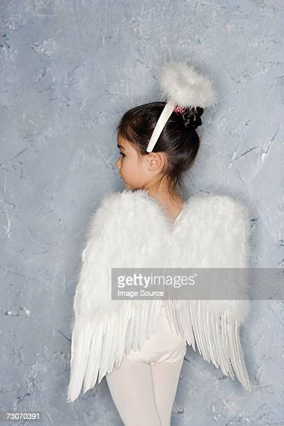 girl in an angel costume - angel stock pictures, royalty-free photos & images