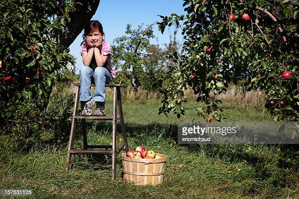 Girl in an orchard