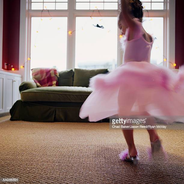 Girl (4-6) in ballerina costume, dancing (blurred motion)