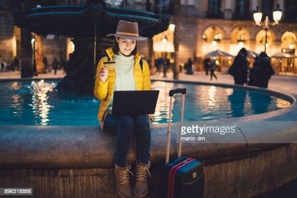 girl in barcelona booking hotel online - making a reservation stock photos and pictures
