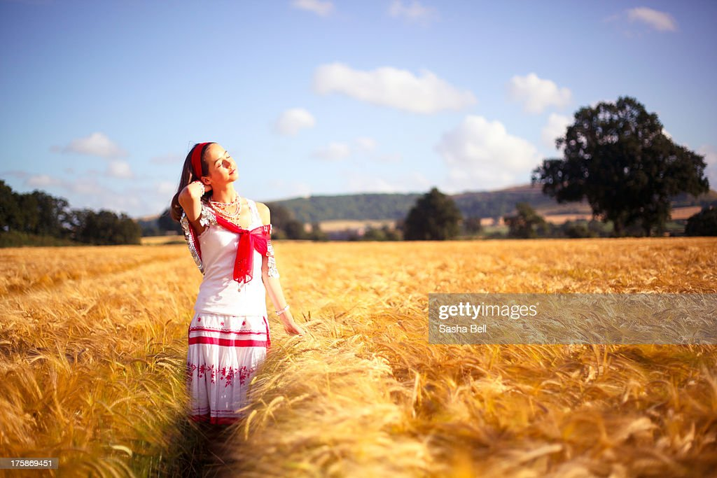 Girl in Barley Field : Stock Photo