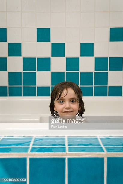 Girl (2-4 years) in bath, smiling, portrait