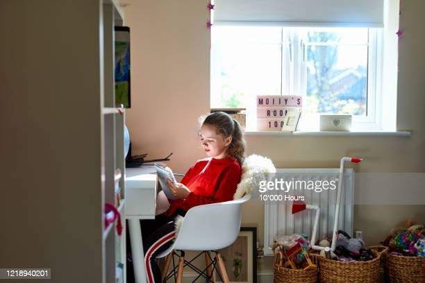 girl in bedroom working on school project during lockdown - improvement stock pictures, royalty-free photos & images