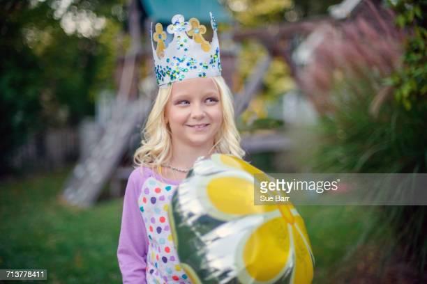 Girl in bejewelled paper crown
