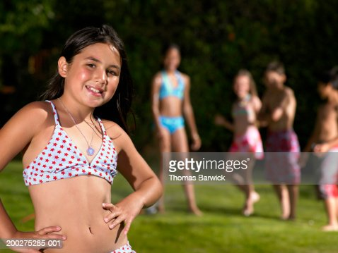 Girl In Bikini Standing Near Other Children Smiling