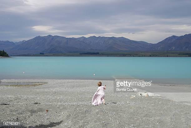 Girl in blanket at lake