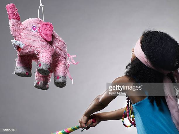 Girl in blue dress with elephant pinata