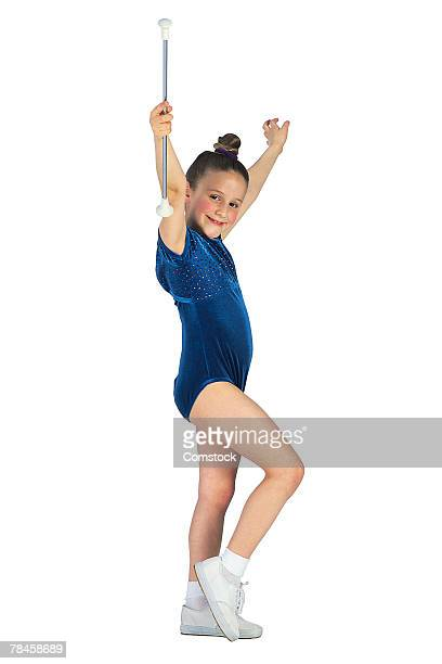 Girl in blue leotard marching with baton